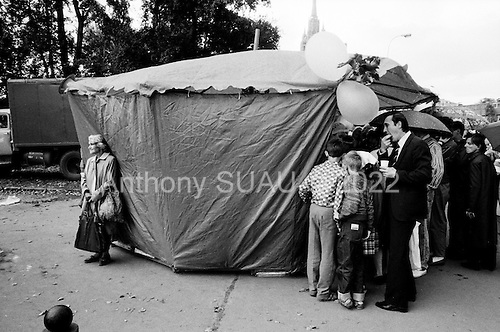 """Moscow, Russia<br /> Soviet Union<br /> August 1991<br /> <br /> Just after a failed coupe on Soviet President Mikhail Gorbachev, people visit the Parliament build where the opposition to the coupe held out.<br /> <br /> In December 1991, food shortages in central Russia had prompted food rationing in the Moscow area for the first time since World War II. Amid steady collapse, Soviet President Gorbachev and his government continued to oppose rapid market reforms like Yavlinsky's """"500 Days"""" program. To break Gorbachev's opposition, Yeltsin decided to disband the USSR in accordance with the Treaty of the Union of 1922 and thereby remove Gorbachev and the Soviet government from power. The step was also enthusiastically supported by the governments of Ukraine and Belarus, which were parties of the Treaty of 1922 along with Russia.<br /> <br /> On December 21, 1991, representatives of all member republics except Georgia signed the Alma-Ata Protocol, in which they confirmed the dissolution of the Union. That same day, all former-Soviet republics agreed to join the CIS, with the exception of the three Baltic States."""
