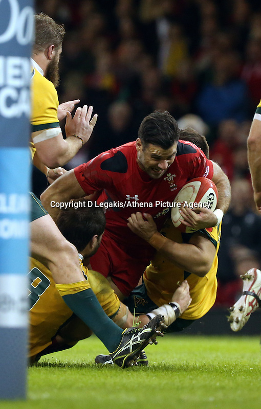 Pictured: Mike Phillips of Wales (with ball) is brought down by two Australia players. Saturday 08 November 2014<br /> Re: Dove Men Series rugby, Wales v Australia at the Millennium Stadium, Cardiff, south Wales, UK.