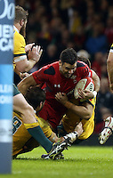 Pictured: Mike Phillips of Wales (with ball) is brought down by two Australia players. Saturday 08 November 2014<br />