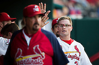 James Ramsey (3) of the Springfield Cardinals high fives teammates in the dugout after scoring during a game against the Northwest Arkansas Naturals at Hammons Field on August 20, 2013 in Springfield, Missouri. (David Welker/Four Seam Images)