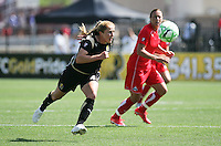 Rachel Buehler (4) chases down the ball against Abby Wambach (right).  Washington Freedom defeated FC Gold Pride 4-3 at Buck Shaw Stadium in Santa Clara, California on April 26, 2009.