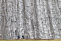 27/02/15  <br /> <br /> Cyclists are dwarfed by thousands of gallons of water from melted snow and days of heavy rain over-spilling down the Derwent Dam in to Ladybower reservoir in the Derbyshire Peak District. <br /> <br /> <br /> All Rights Reserved - F Stop Press.  www.fstoppress.com. Tel: +44 (0)1335 418629 +44(0)7765 242650