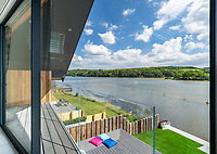 BNPS.co.uk (01202 558833)<br /> Pic: ShorePartnership/BNPS<br /> <br /> Pictured: Outside and the view of Restronguet Creek.<br /> <br /> A brand new waterfront home perfect for paddleboarders is on the market for £1.3m.<br /> <br /> Creek View is built on a former boatyard and has direct water access to Restronguet Creek from steps in the back garden.<br /> <br /> The contemporary four-bedroom house has an open-plan living space and floor-to-ceiling glass overlooking the water to make the most of its stunning location.