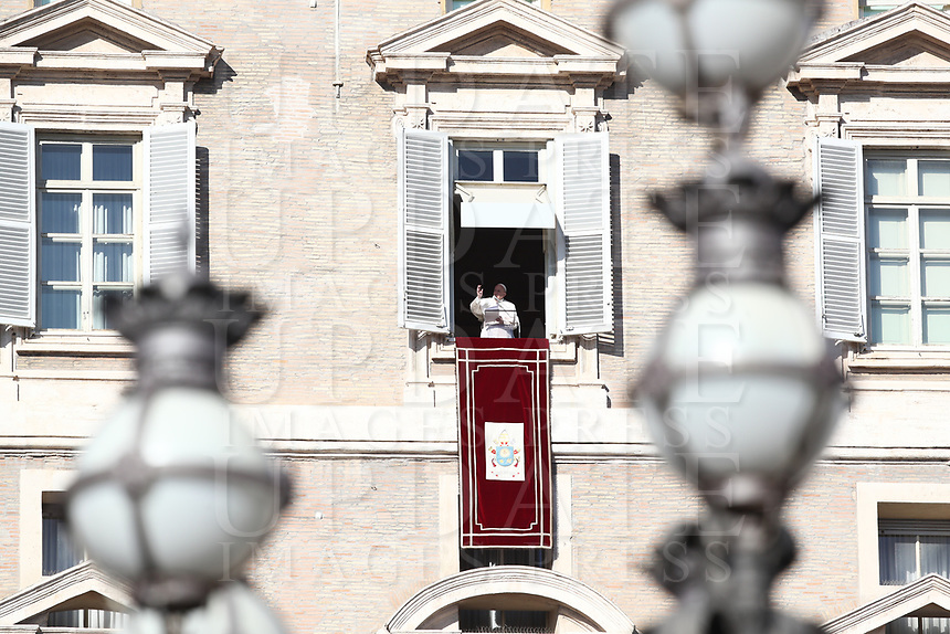 Papa Francesco recita l'Angelus affacciato su piazza San Pietro dalla finestra del suo studio. Citta' del Vaticano 26 dicembre 2019.<br /> Pope Francis recites the Angelus noon prayer from the window of his studio overlooking St. Peter's Square, at the Vatican, on December 26, 2019.<br /> UPDATE IMAGES PRESS/Isabella Bonotto<br /> <br /> STRICTLY ONLY FOR EDITORIAL USE