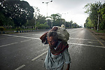 An old man carries goods on a deserted street in Kolkata during the 2nd phase of lockdown in India due to covid 19 pandemic. Kolkata, West Bengal, India. Arindam Mukherjee