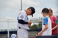 Tampa Tarpons shortstop Diego Castillo (19) signs autographs for fans before a game against the Clearwater Threshers on April 22, 2018 at George M. Steinbrenner Field in Tampa, Florida.  Tampa defeated Clearwater 2-1.  (Mike Janes/Four Seam Images)