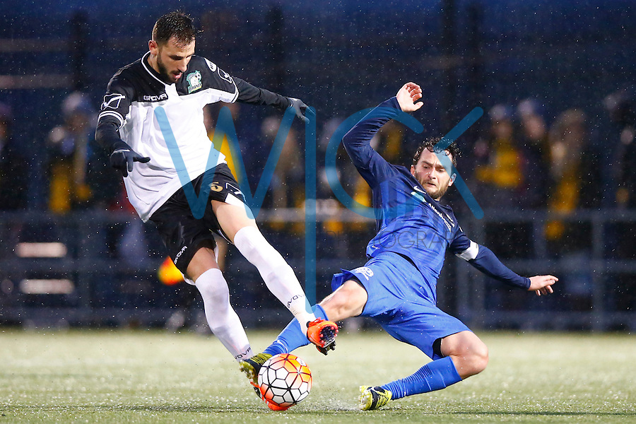 Kevin Kerr #10 of the Pittsburgh Riverhounds slide tackles Vassilios Apostolopoulos #5 of the Rochester Rhinos in the first half during the match at Highmark Stadium in Pittsburgh, Pennsylvania on April 2, 2016. (Photo by Jared Wickerham / DKPS)