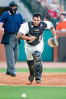 Greensboro catcher Blake Ochoa (7) chases a wild pitch versus Kannapolis at First Horizon Park in Greensboro, NC, Sunday, May 27, 2007.  The Intimidators defeated the Grasshoppers 6-5.