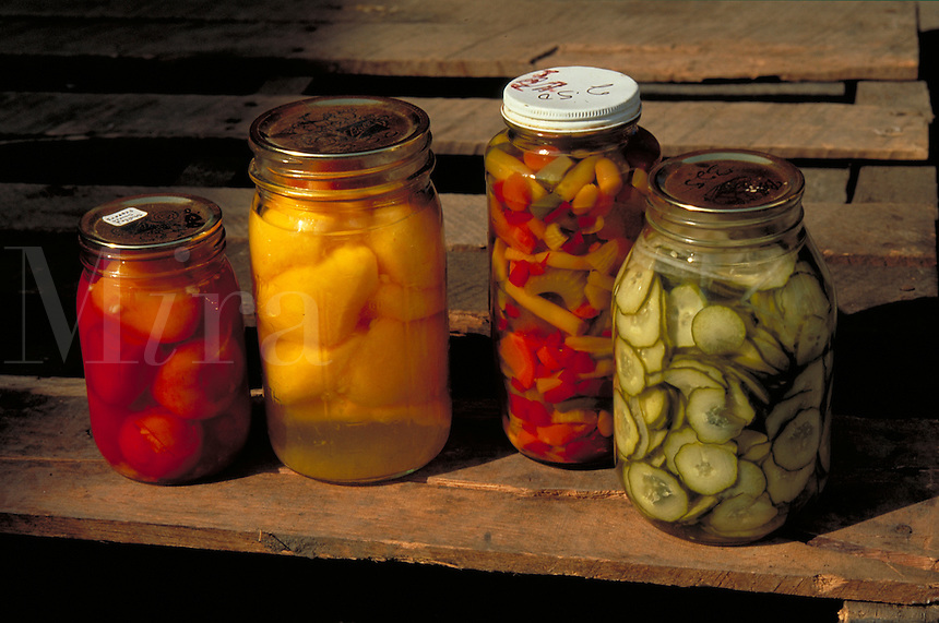 Home canned vegetables and fruit on an old wood bench. Strasburg Pennsylvania USA Lancaster County.