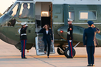 Vice President Kamala Harris salutes U.S. Marines as she disembarks Marine Two at Joint Base Andrews, Maryland, Friday, June 25, 2021, to begin her trip to El Paso, Texas. (Official White House Photo by Lawrence Jackson)