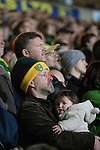 Norwich City 1 Manchester United 0, 17/11/2012. Carrow Road, Premier League. Home supporters watching the second-half action at Carrow Road stadium, home of Norwich City as their team take on Manchester United in a Barclays Premier League fixture. The home team won the match by one goal to nil watched by a crowd of 26,840. It was Norwich City's first victory against Manchester United since 2005. Photo by Colin McPherson.