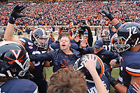 ANDREW SHURTLEFF/THE DAILY PROGRESS <br /> Virginia head coach Bronco Mendenhall is doused with water after defeating Virginia Tech 39-30 to win the Commonwealth Clash Friday in Charlottesville.