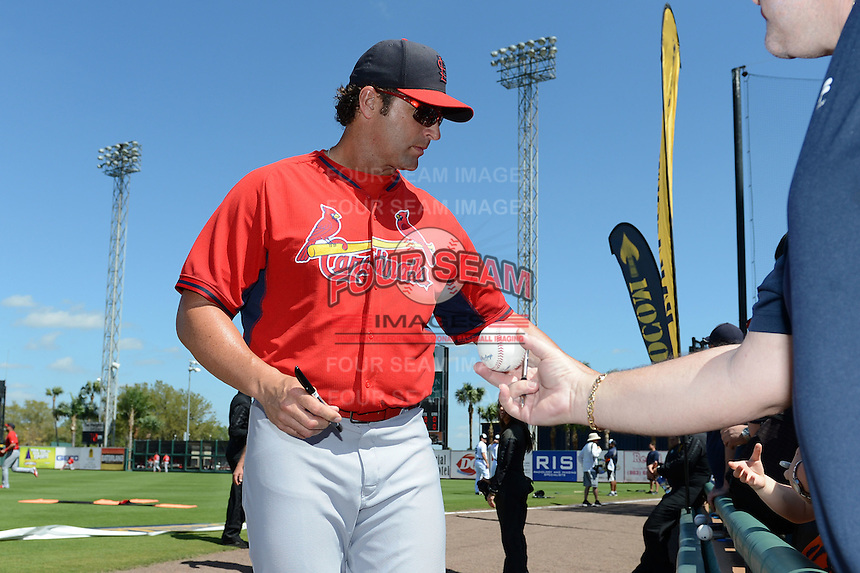 St. Louis Cardinals manager Mike Matheny (22) signs autographs before a spring training game against the Detroit Tigers on March 3, 2014 at Joker Marchant Stadium in Lakeland, Florida.  Detroit defeated St. Louis 8-5.  (Mike Janes/Four Seam Images)
