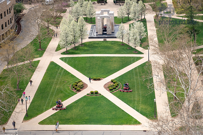 May 4, 2018; Grounds crews mow the lawn near the Clarke Memorial Fountain, commonly known as Stonehenge. (Photo by Matt Cashore/University of Notre Dame)