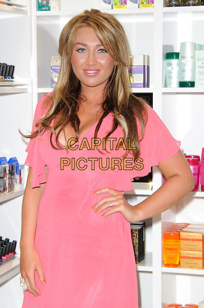 Lauren Goodger.N'OW @ Regis Nail & Brow Bar - launch - TOWIE star meets fans and signs autographs at the launch of Regis Hair Salon's new nail bar, Romford, England..June 3rd, 2011.half length pink dress hand on hip .CAP/CJ.©Chris Joseph/Capital Pictures.