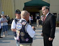 Saturday, Sept. 11, 2021, during a ceremony marking the 20th anniversary of the Sept. 11, 2001, terrorist attack at the Springdale Senior Center. The ceremony was organized by Bo's Blessings and featured the reading of names of people killed during the attacks including those with Arkansas roots before Sen. John Boozman spoke. Visit nwaonline.com/210912Daily/ for today's photo gallery.<br /> (NWA Democrat-Gazette/Andy Shupe)