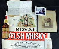 "Pictured: One of the bottles of whisky dating back to almost 120 years which is auctioned off by Peter Francis Auctioneers in Carmarthen Wales.<br /> Re: Two bottles of Welsh whisky dating back almost 120 years could fetch £3,000 each when they are put up for auction.<br /> The Welsh Whisky Distillery Company bottles are being auctioned online from Thursday until 5 December by Peter Francis Auctioneers in Carmarthen.<br /> The whisky was bought by a wine merchant in Fishguard, Pembrokeshire, in the 1960s for £5 each.<br /> Auctioneer Charles Hampshire said: ""It's such a rare thing - the only other ones we know of are on display.""<br /> The Welsh Whisky Distillery Company was founded in Frongoch, Bala, Gwynedd in 1889 but closed in the early 20th Century.<br /> The distillery became a World War One prison camp - and more famously, an internment camp after the Easter Rising in the Republic of Ireland.<br /> The bottles, dating back to about 1900, will go up in two separate lots, each with supporting paperwork."