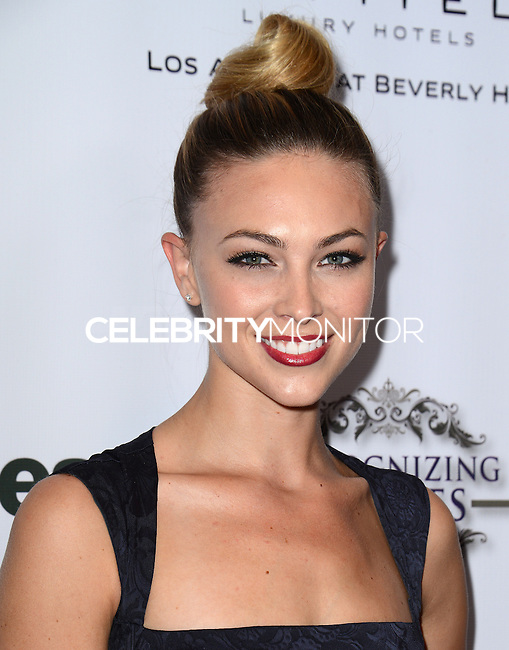 LOS ANGELES, CA, USA - NOVEMBER 08: Courtney Hope Turner arrives at the Unlikely Heroes' 3rd Annual Awards Dinner And Gala held at the Sofitel Hotel on November 8, 2014 in Los Angeles, California, United States. (Photo by Celebrity Monitor)