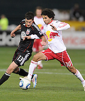 New York Red Bulls midfielder Mehdi Ballouchy (10) shields the ball against DC United midfielder Chris Pontius (13)  The New York Red Bulls defeated DC United 4-0, at RFK Stadium, Saturday April 21, 2011.