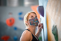 Becky Butler works on her bouldering as Alaska Rock Gym operations manager and UAA recreation course instructor Eric Wickenheiser teaches Beginning Indoor Sport Climbing (PER A148) at the Alaska Rock Gym in Anchorage.