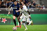 Alessandro Bastoni of FC Internazionale and Vinicius Junior of Real Madrid during the Uefa Champions League group D football match between FC Internazionale and Real Madrid at San Siro stadium in Milano (Italy), September 15th, 2021. Photo Andrea Staccioli / Insidefoto