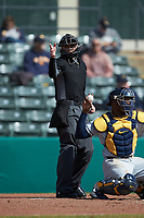 Home plate umpire Anthony Perez makes a strike call during the NCAA baseball game between the West Virginia Mountaineers and the Illinois Fighting Illini at TicketReturn.com Field at Pelicans Ballpark on February 23, 2020 in Myrtle Beach, South Carolina. The Fighting Illini defeated the Mountaineers 2-1.  (Brian Westerholt/Four Seam Images)