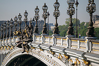 Le Pont Alexander III spans the river Seine leading to Les Invalides in Paris, France