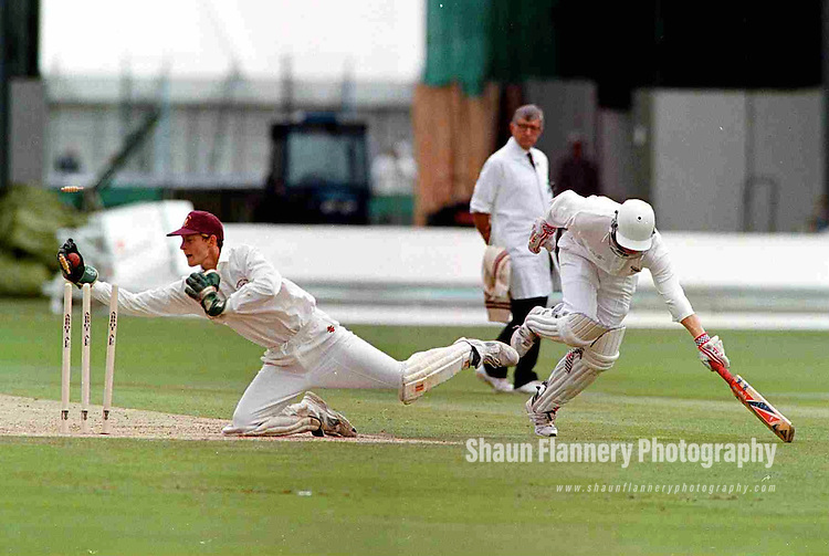 Pix: Shaun Flannery/shaunflanneryphotography.com...COPYRIGHT PICTURE>>SHAUN FLANNERY>01302-570814>>07778315553>>..28th August 1998..............Doncaster Town v Bath..Abbot Ale Cup final at Lords..Doncaster Town wicketkeeper Simon Widdup makes a valiant effort as Bath's Stuart Priscott notches up another run during the 1998 Abbot Ale Cup at Lords.