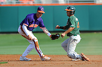 Second Baseman Steve Wilkerson #17 fields the throw as a hard sliding Stephen Perez gets in under the tag during a  game against the Miami Hurricanes at Doug Kingsmore Stadium on March 31, 2012 in Clemson, South Carolina. The Tigers won the game 3-1. (Tony Farlow/Four Seam Images).