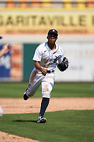 Detroit Tigers second baseman Wenceel Perez (80) throws to third base in a run down during a Minor League Spring Training game against the Baltimore Orioles on April 14, 2021 at Joker Marchant Stadium in Lakeland, Florida.  (Mike Janes/Four Seam Images)