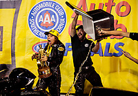 Nov 17, 2019; Pomona, CA, USA; NHRA pro stock motorcycle rider Jianna Salinas is doused with a cooler of ice water as she celebrates with crew after winning the Auto Club Finals at Auto Club Raceway at Pomona. Mandatory Credit: Mark J. Rebilas-USA TODAY Sports