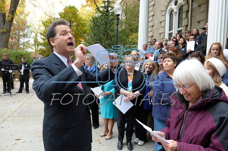 """Lt. Gov. Brian Krolicki talks to the crowd gathered on the Capitol steps Thursday, Oct. 30, 2014 before #NevadaSings!, a statewide sing-a-long of """"Home Means Nevada."""" Approximately 370 people took part  in the Carson City portion of the event, which seeks to establish a new record for the most people in an American state to sing their state song at the same time."""