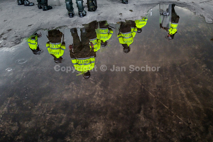 Colombian policemen patrol along a march route during a protest march against government's policies and corruption within the public educational system in Bogotá, Colombia, 24 October 2019.
