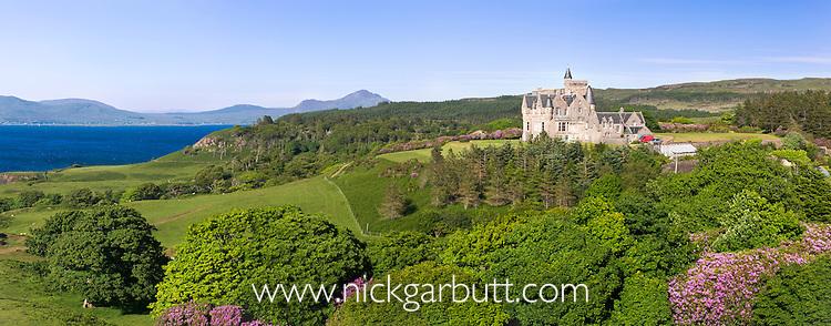 Glengorm Castle, Glengorm Estate on the Isle of Mull, Inner Hebrides, Scotland, UK (with the Scotish mainland, Ardnamurchan Peninsulain, in the background). June 2010.