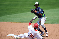 Vermont Lake Monsters shortstop Eric Marinez (2) throws to first as Daniel Johnson (30) slides into second during a game against the Auburn Doubledays on July 13, 2016 at Falcon Park in Auburn, New York.  Auburn defeated Vermont 8-4.  (Mike Janes/Four Seam Images)