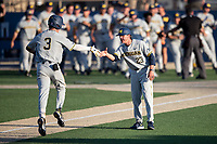 Michigan Wolverines designated hitter Ted Burton (3) is greeted by third base coach Nick Schnabel (23) after hitting a home run during the NCAA baseball tournament against the Connecticut Huskies on June 4, 2021 at Frank Eck Stadium in Notre Dame, Indiana. The Huskies defeated the Wolverines 6-1. (Andrew Woolley/Four Seam Images)