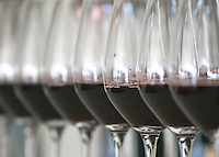 A row of glasses filled with wine for tasting in the tasting room Chateau Paloumey Haut-Medoc Ludon Medoc Bordeaux Gironde Aquitaine France