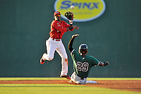 Kelvin Beltre (29) of the Augusta GreenJackets is out at second as Luis Alejandro Basabe (5) of the Greenville Drive turns the double play in a game on Friday, June 10, 2016, at Fluor Field at the West End in Greenville, South Carolina. (Tom Priddy/Four Seam Images)