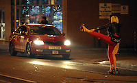 Pictured: A woman makes raises her leg up in the air in a desperate attempt to get a taxi ride in the early hours of Saturday, 17 December, 2016<br />