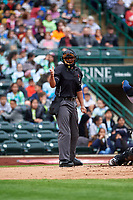 Home plate umpire Thomas Burrell calls a strike during a Midwest League game between the Kane County Cougars and Fort Wayne TinCaps at Parkview Field on May 1, 2019 in Fort Wayne, Indiana. Fort Wayne defeated Kane County 10-4. (Zachary Lucy/Four Seam Images)