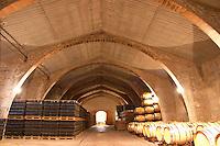 Wine aging in oak barrels. Modernista style vaulted winery. Raimat Costers del Segre Catalonia Spain