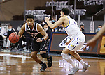 SIOUX FALLS, SD - MARCH 6: Ayo Akinwole #10 of the Nebraska-Omaha Mavericks looks past Matt Mims #1 of the South Dakota State Jackrabbits during the Summit League Basketball Tournament at the Sanford Pentagon in Sioux Falls, SD. (Photo by Dave Eggen/Inertia)