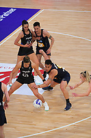 Maia Wilson receives a pass under pressure from Jake Schuster during the Cadbury Netball Series final between NZ Silver Ferns and NZ Men at the Fly Palmy Arena in Palmerston North, New Zealand on Saturday, 24 October 2020. Photo: Dave Lintott / lintottphoto.co.nz