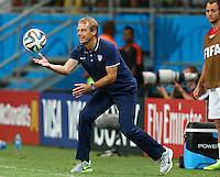 USA coach Juergen Klinsmann throws the ball back into play