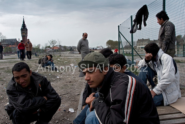 """Calais, France.April 26, 2007..Refugees from Afghanistan wait in Calais in the north of France in the hopes of getting across the channel to Great Britain. They attempt to get there by jumping into trucks that load up on ships and cross the channel. They sleep in makeshift homes in the brush near the coast in what they call the """"Jungle"""". The conditions are very tough but some wait as long as 6 months to cross..."""