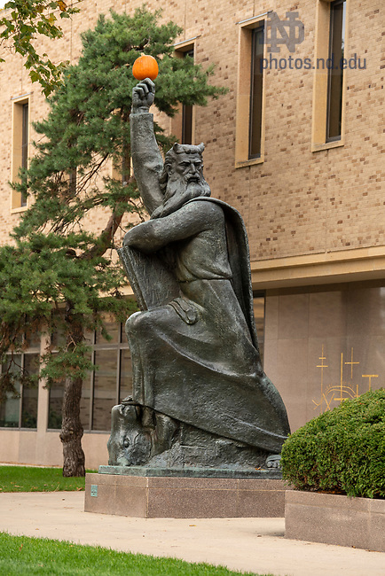 October 28, 2019; Moses statue with a pumpkin.  (Photo by Barbara Johnston/University of Notre Dame)