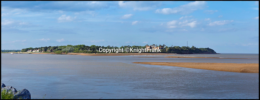 BNPS.co.uk (01202 558833)<br /> Pic: KnightFrank/BNPS<br /> <br /> Viewed from the other side of the Deben estuary.<br /> <br /> Making waves - Seaside Suffolk mansion that was in the frontline of the top secret battle to defeat the luftwaffe during WW2 is on the market.<br /> <br /> A stunning Grade II* listed coastal manor house which was Britain's first radar station and survived multiple Luftwaffe attacks is now up for grabs.<br /> <br /> Bawdsey Manor is a home fit for royalty - a grand 144-acre estate on the Suffolk coast with a mansion that looks like the Queen's much-loved Sandringham House nearby.<br /> <br /> The impressive property, which also comes with quayside cottages and even has its own beach access, is on the market with estate agents Knight Frank with a guide price of £5million.