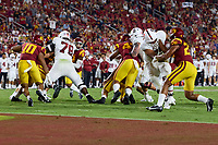 LOS ANGELES, CA - SEPTEMBER 11: Myles Hinton #78 and Walter Rouse #75 of the Stanford Cardinal block for a running play during a game between University of Southern California and Stanford Football at Los Angeles Memorial Coliseum on September 11, 2021 in Los Angeles, California.