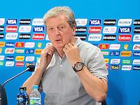 England manager Roy Hodgson pulls at his collar
