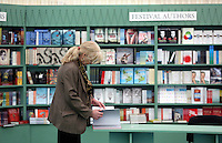 Friday 23 May 2014, Hay on Wye UK<br /> Pictured: People browing through books in the book store.<br /> Re: The Telegraph Hay Festival, Hay on Wye, Powys, Wales UK.